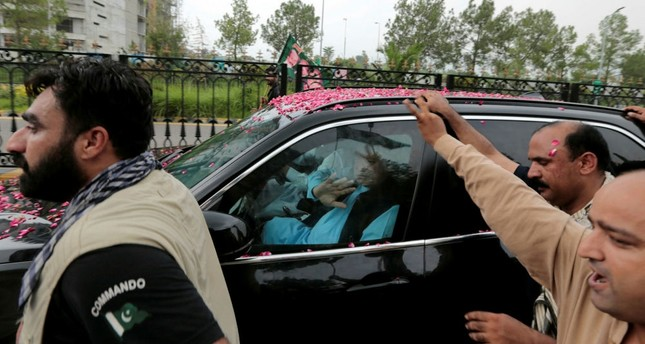 Former Pakistani Prime Minister Nawaz Sharif waves at supporters as his convoy leaves Islamabad, Aug. 9.