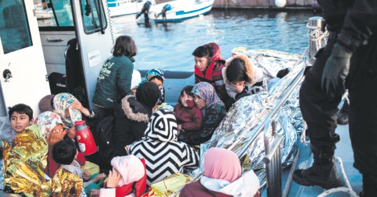 Migrants are seen on board a Greek Coast Guard rescue boat at the port of Skala Sikamias  following a rescue operation by a Frontex patrol vessel, on the island of Lesbos, Sept. 29, 2019.