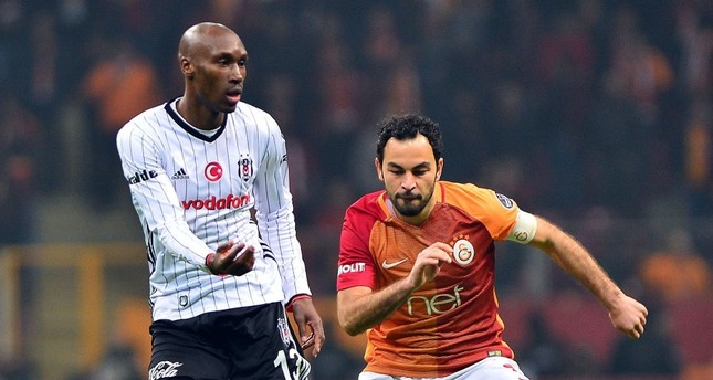 Galatasaray's Selçuk Şahin, right, vies for ball with Beşiktaş's Anderson Talisca, left, during the Super League match at the Türk Telekom Arena Stadium in Istanbul.