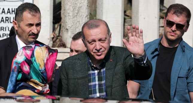 President Recep Tayyip Erdoğan waves at citizens and members of the press after visiting the graves of his parents on the occasion of Ramadan Bayram, at Karacaahmet Cemetery in Üsküdar district of Istanbul, June 5, 2019. (DHA Photo)