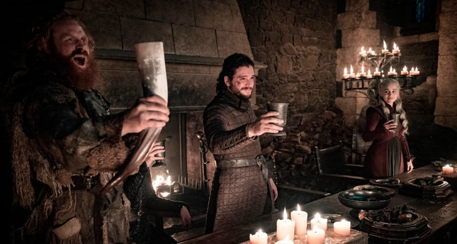 This image released by HBO shows Kristofer Hivju, from left, Kit Harington and Emilia Clarke in a scene from Game of Thrones. (HBO via AP Photo)