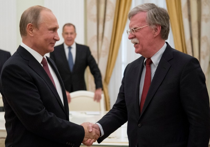 Russian President Vladimir Putin, left, shakes hands with U.S. National Security Adviser John Bolton during a meeting at the Kremlin in Moscow, Russia, June 27, 2018. (Reuters Photo)