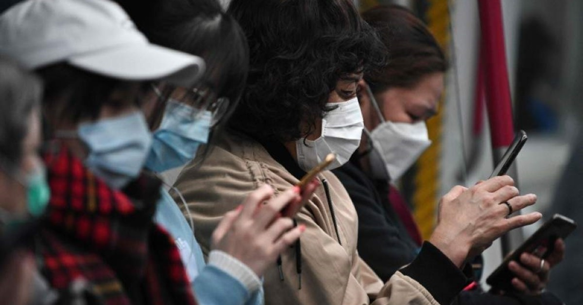 Commuters wear face masks as they travel on a MTR underground metro train in Hong Kong on Feb. 4, 2020. (AFP Photo)
