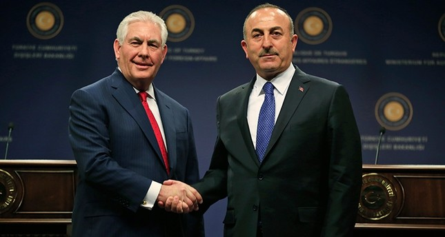 Foreign Minister Mevlut Cavusoglu, right, shakes hands with U.S. Secretary of State Rex Tillerson, left, following a news conference after their meeting in Ankara, Turkey, March 30, 2017. (AP Photo)