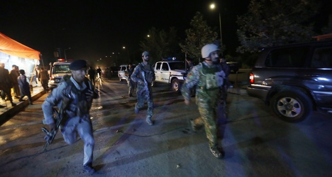 Afghan security forces rush to respond to a complex Taliban attack on the campus of the American University in the Afghan capital Kabul on Wednesday, Aug. 24, 2016. (AP Photo)