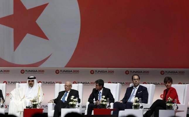 Emir of Qatar Sheikh Tamim bin Hamad Al-Thani (L) Tunisian President Beji Caid Essebsi (2-L) French PM Manuel Valls (C) Tunisian PM Youssef Chahed (2-R) Min. of International Development and La Francophonie Mandate of Canada Marie Claude Bibeau (R)
