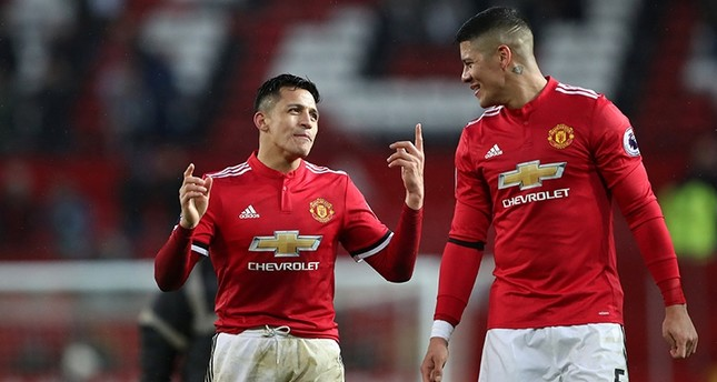 Manchester United's Alexis Sanchez and Marcos Rojo celebrate after the match on Feb. 3, 2018. (Reuters Photo)