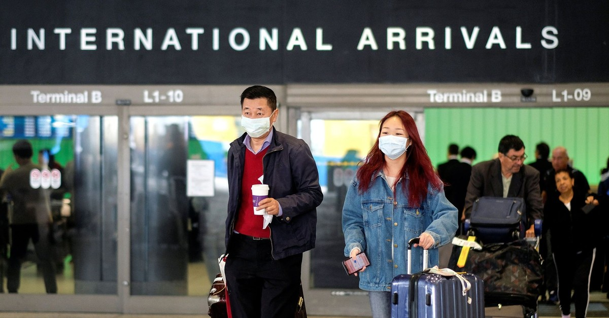 Passengers leave LAX after arriving from Shanghai, China, after a positive case of the coronavirus was announced in the Orange County suburb of Los Angeles, Jan. 26, 2020. (Reuters Photo)