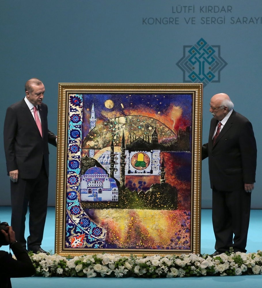 Culture and Tourism Minister Nabi Avcu0131 presenting a painting to President Erdou011fan during the inauguration of the Third National Cultural Council, Istanbul, March 3.