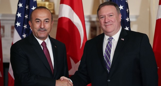 U.S. Secretary of State Mike Pompeo (R), greets Foreign Minister Mevlüt Çavuşoğlu, before a meeting at the Department of State on June 4, 2018 in Washington, D.C. (AFP Photo)
