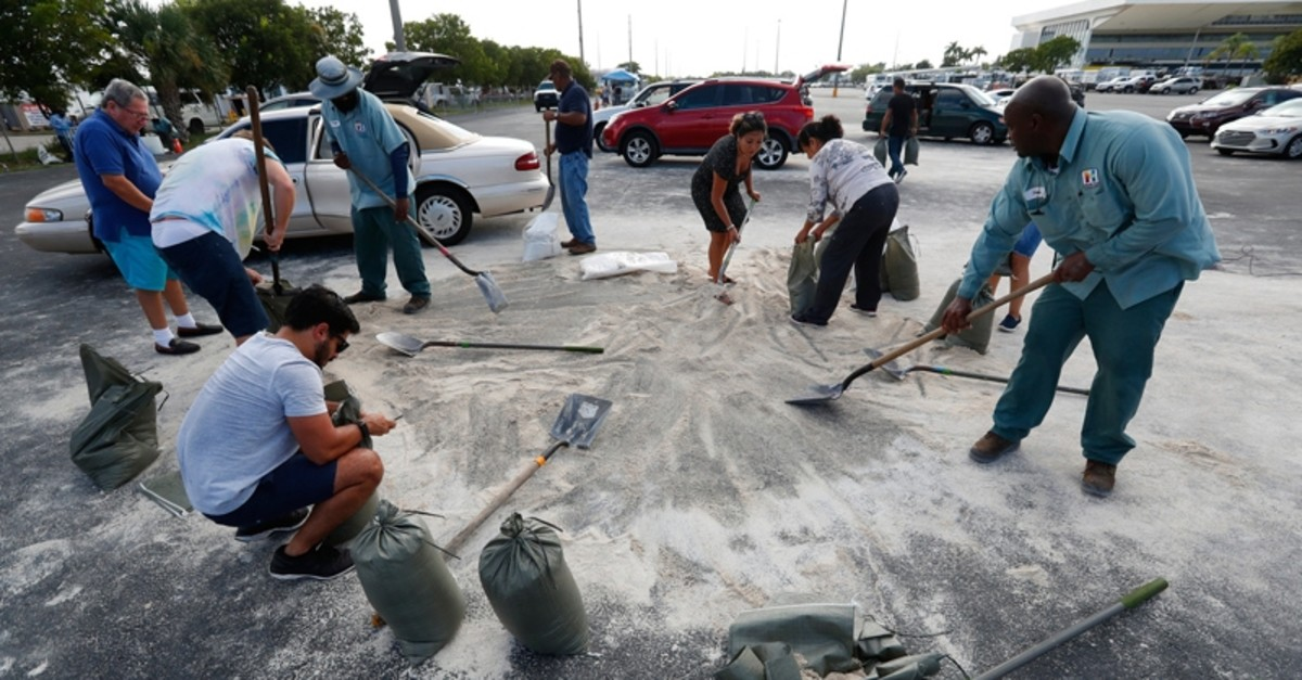 Residents fill up sandbags with the last bits of sand available in preparation for Hurricane Dorian, Friday, Aug. 30, 2019, in Hallandale Beach, Fla. (AP Photo)