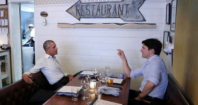 Canada's Prime Minister Justin Trudeau speaks with former United States President Barack Obama at a restaurant during Obama's visit to address the Montreal Chamber of Commerce, in Montreal, Quebec, Canada June 6, 2017 Reuters Photo
