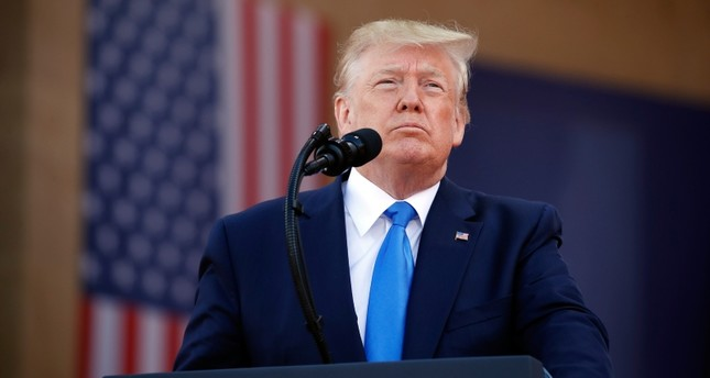 President Donald Trump speaks during a ceremony to commemorate the 75th anniversary of D-Day at The Normandy American Cemetery, Thursday, June 6, 2019, in Colleville-sur-Mer, Normandy, France. (AP Photo)