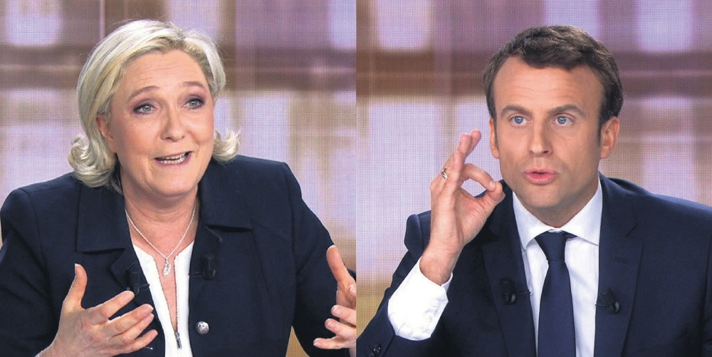 French presidential election candidate Marine Le Pen and French presidential election candidate Emmanuel Macron talks during a face to face debate ahead of the second round of the French presidential election during a live broadcast on May 3.