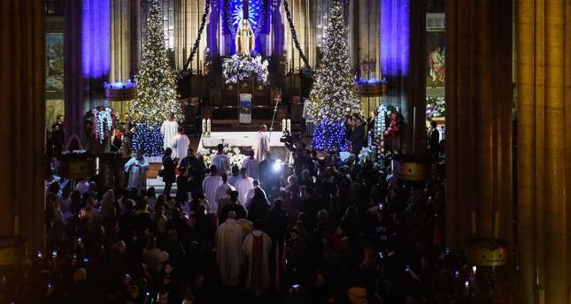 Christians attend Christmas Eve mass at Saint Antoine Church in Istanbul's Beyoğlu district, Dec. 24, 2018. (DHA Photo)