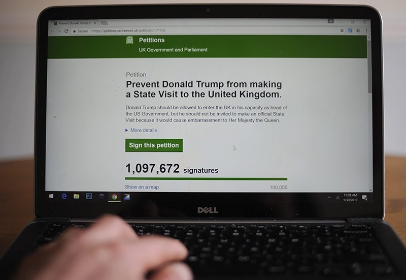 An online petition to 'Prevent President Donald Trump from making a State Visit to the United Kingdom' is seen on a laptop screen in London, Britain 30 January 2017. (EPA Photo)