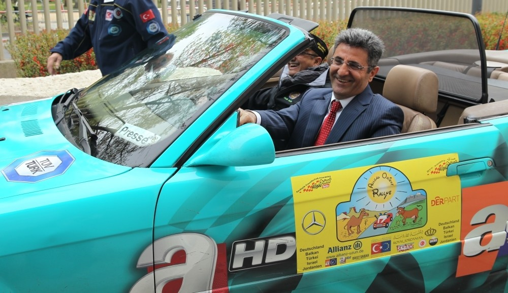 Turkish Ambassador to Berlin Ali Kemal Aydu0131n drives a rally car at a press conference to introduce the rally on April 21.