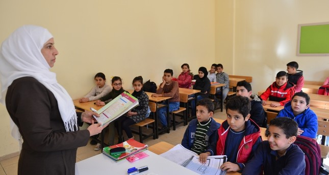Children in a classroom at the newly opened Kuwaiti-Turkish Friendship School.