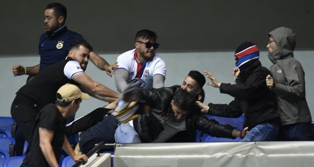 Lyon's fans were so prepared that some of them wore masks before attacking the Turkish fans during the UEFA Europa League Quarter Final First Leg at Parc Olympique Lyonnais on Apr. 13.