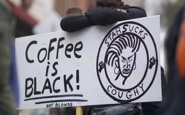 Protestor Jack Willis, 26, demonstrates outside a Starbucks on April 15, Philadelphia, Pennsylvania.