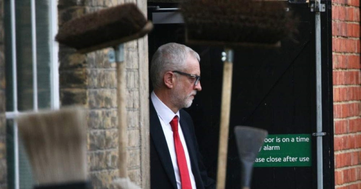 Britain's opposition Labour Party leader Jeremy Corbyn leaves Islington Town Hall through the backdoor after a meeting following the results of the general election in London, Britain, December 13, 2019. (REUTERS Photo)