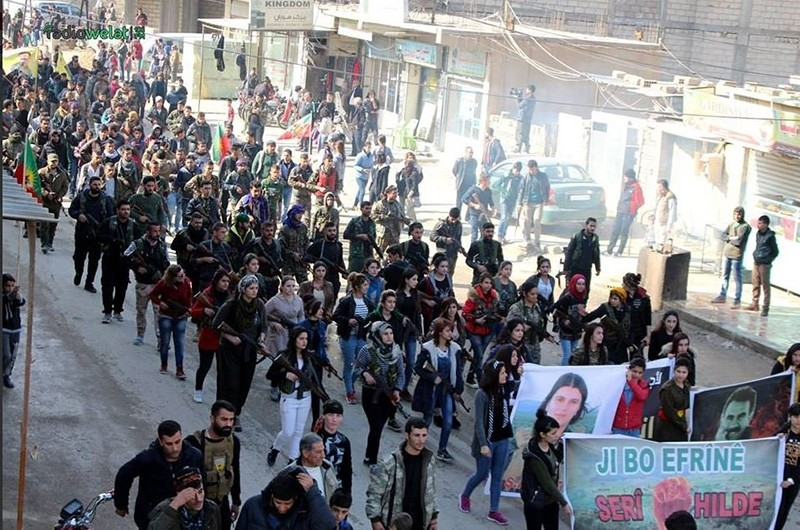 This file photo shows a ,solidarity march, in Syria, in which participants in civilian clothing carry rifles, banners of PKK/PYD/YPG and its jailed leader Abdullah u00d6calan. Some 500 terrorists are estimated to cross into Afrin through such convoys.