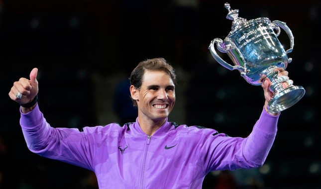 Rafael Nadal, of Spain, holds up the championship trophy after defeating Daniil Medvedev, of Russia, to win the men's singles final of the U.S. Open tennis championships Sunday, Sept. 8, 2019, in New York. AP Photo