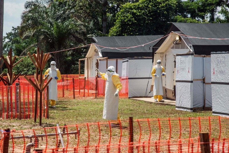 In this file photo taken on June 1, 2018 health workers operate within an Ebola safety zone in the Health Center in Iyonda, near Mbandaka. (AFP Photo)