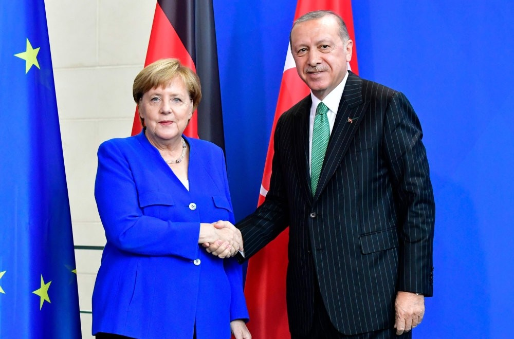 President Recep Tayyip Erdou011fan and German Chancellor Angela Merkel shake hands at a joint press conference after bilateral talks in Berlin, Sept. 28.