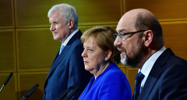 German Chancellor Angela Merkel's conservatives reached a breakthrough deal with the country's second biggest party, the Social Democrats, toward building a new coalition government, sources close to the negotiations said. (AFP Photo)