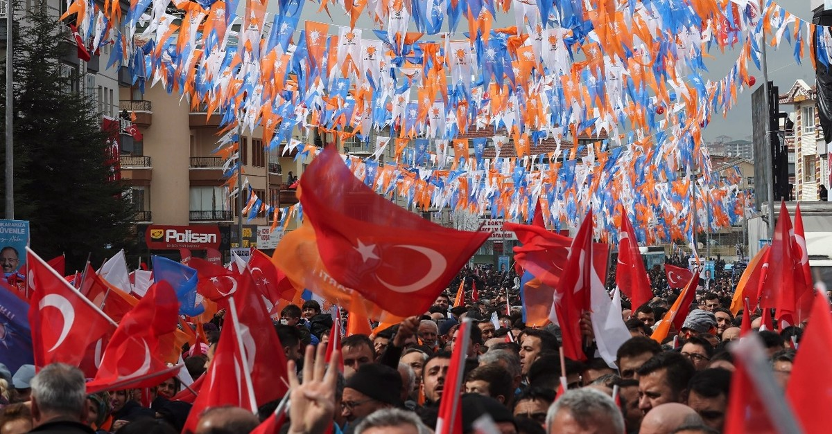 People wave flags as they gather to listen to President Erdou011fan during a campaign rally for the upcoming March 31 elections, Ankara, March 13, 2019.