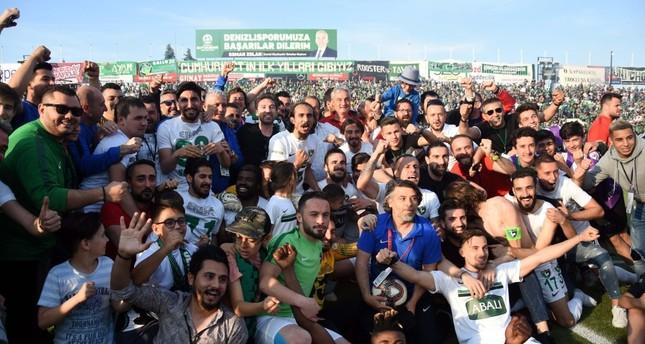 Denizlispor fans celebrate their team's 6-0 win against Karabükspor at home, May 12, 2019.