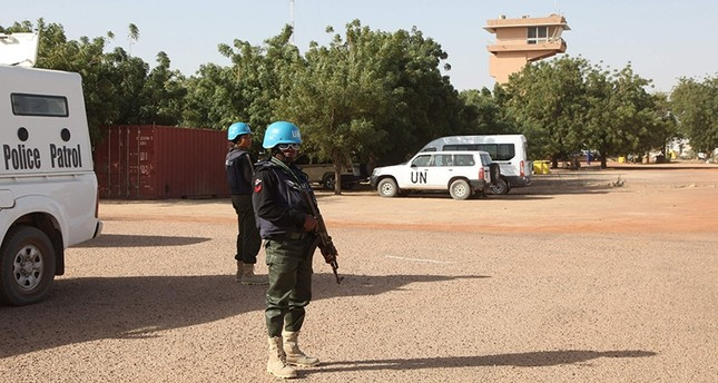 This file photo taken on February 04, 2016 shows UN peacekeepers standing guard near Timbuktu's airport. (AFP Photo)