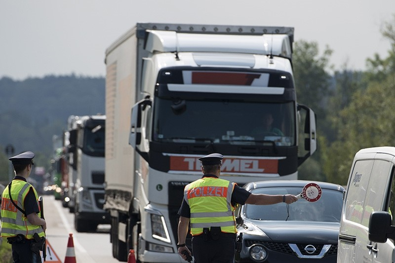 Police officers check cars and trucks during a border inspection post at the German border to Austria in Kirchdorf am Inn, Bavaria, Germany, July 18, 2018. (EPA Photo)