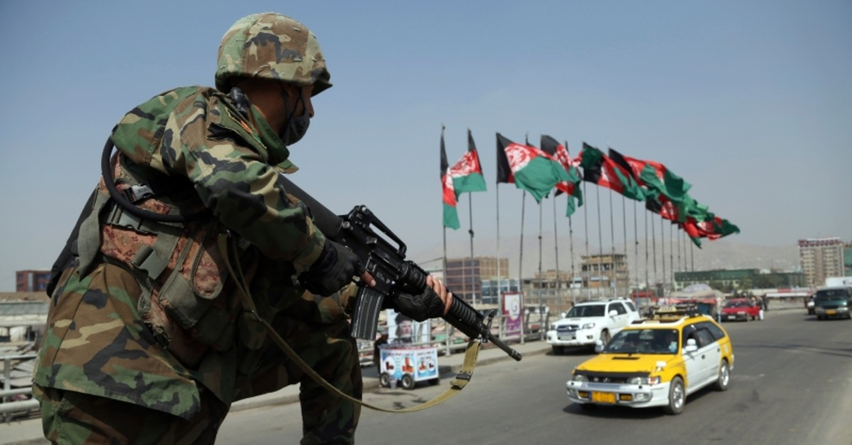 In this Tuesday, Sept. 24, 2019 photo, An Afghan National Army soldier stand guard at a checkpoint ahead of presidential elections scheduled for Sept. 28, in Kabul, Afghanistan.
