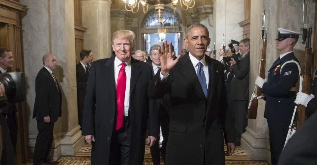 Then U.S. President-elect Donald Trump and former U.S. President Barack Obama arrive for Trump's inauguration ceremony at the Capitol in Washington, D.C., Jan. 20, 2017. (AP Photo)