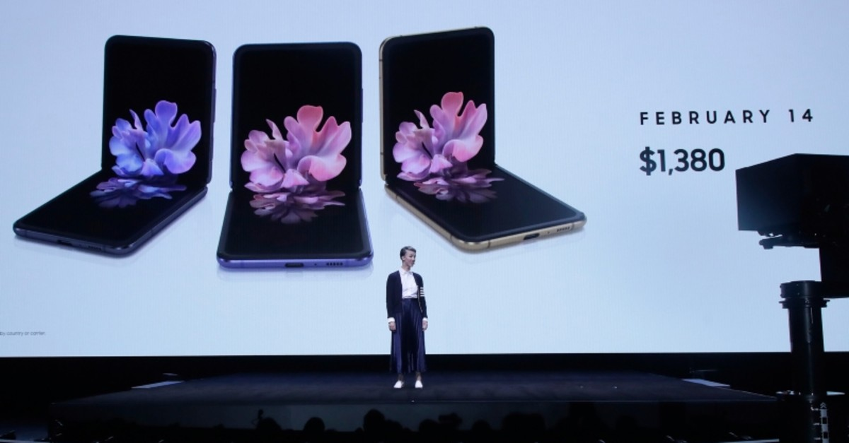 Rebecca Hirst, head of UK Mobile Product Development, speaks in front of photos of Samsung Galaxy Z Flip Phones at the Unpacked 2020 event in San Francisco, Tuesday, Feb. 11, 2020. ( AP Photo)