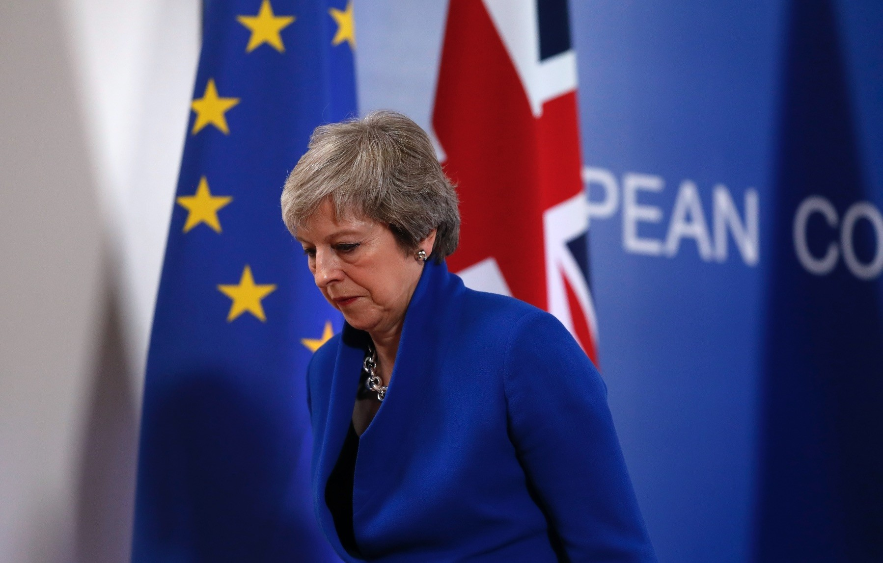 British Prime Minister Theresa May leaves the podium after a media conference, Brussels, Nov. 25.