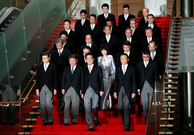 Japan's Prime Minister Shinzo Abe leads his cabinet ministers as they attend a photo session at his official residence in Tokyo, Japan October 2, 2018. (Reuters Photo)