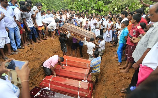 In this Saturday, May 27, 2017, file photo, Sri Lankan villagers prepare to bury victims of a landslide at a cemetery in Bellana village, in Kalutara district in, Sri Lanka. Sri Lanka has appealed for outside help as dozens were killed in floods and