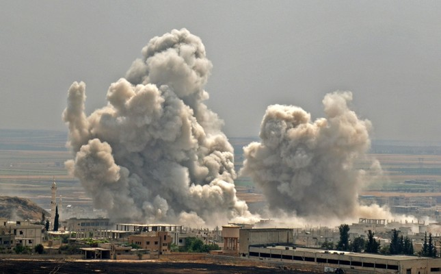 Plumes of smoke rise following reported bombardment by the regime of Bashar Assad on Khan Sheikhun, southern Idlib province, Syria, June 7, 2019. (AFP Photo)