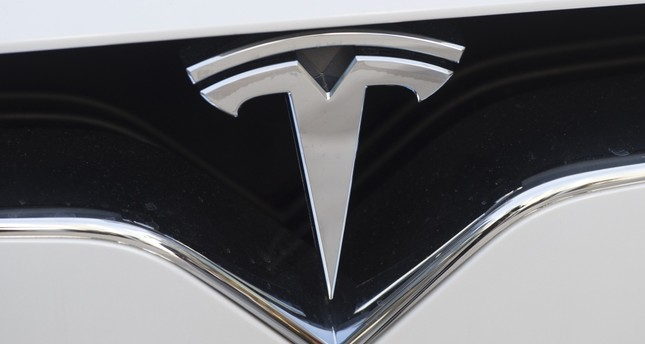 Tesla reports record deliveries in 1st quarter