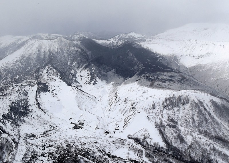 Photo taken from a Kyodo News helicopter Jan. 23, 2018, shows the area surrounding Mt. Kusatsushirane (top, L) in Gunma Prefecture, northwest of Tokyo, which erupted on the same day. (Kyodo via Reuters)