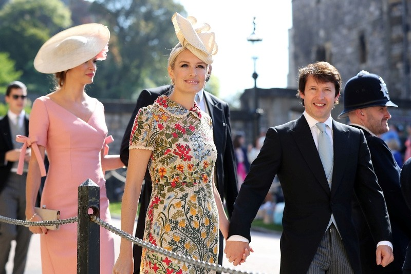 British singer James Blunt (R) and his wife Sofia Wellesley arrive for the wedding ceremony of Britain's Prince Harry, Duke of Sussex and US actress Meghan Markle at St George's Chapel, Windsor Castle, in Windsor, on May 19, 2018.