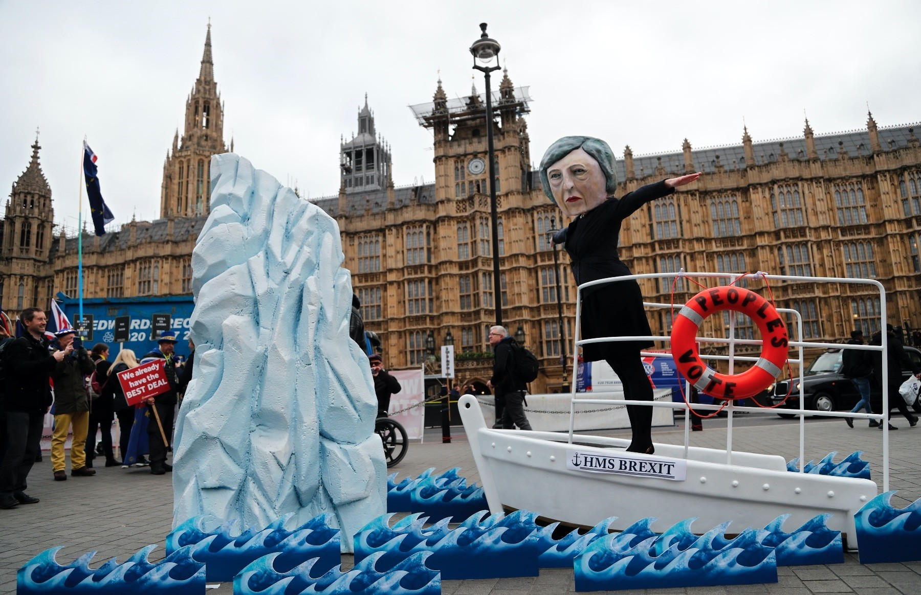 An activist wears a mask of Britainu2019s Prime Minister Theresa May during an anti-Brexit demonstration, in front of the Houses of Parliament, London, Jan. 15.
