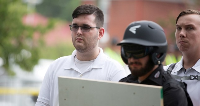 James Alex Fields Jr., (L) is seen attending the Unite the Right rally in Emancipation Park before being arrested by police. (REUTERS Photo)