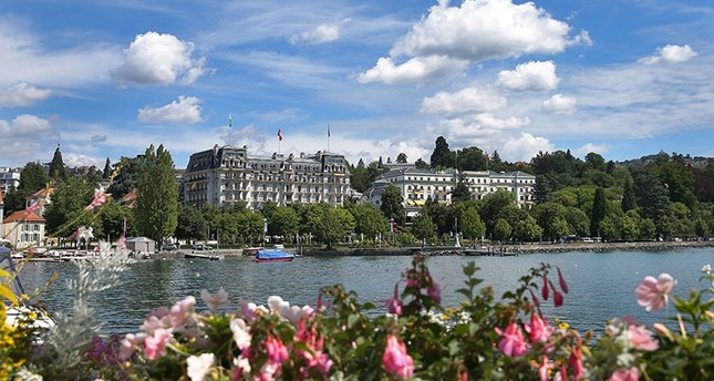 The Beau Rivage Hotel in Lausanne, where the Treaty of Lausanne was signed, is seen across the Lake Geneva, Switzerland, July 24, 2017. (AA Photo)