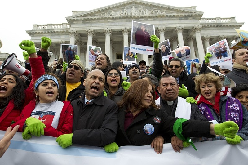 Demonstrators protest outside of the U.S. Capitol in support of the Deferred Action for Childhood Arrivals (DACA), and Temporary Protected Status (TPS), programs, during an rally on Capitol Hill in Washington, Dec. 6, 2017. (AP Photo)