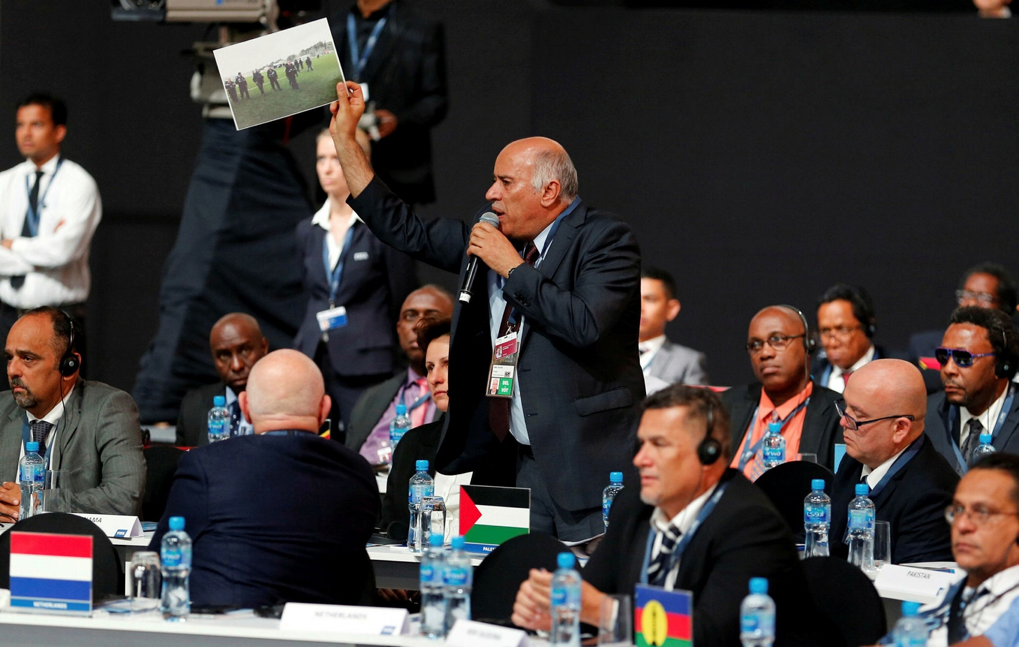 Palestinian Football Association (PFA) President Jibril Rajoub shows a photo mentioning Israeli soldiers on soccer ground in Palestine, at the 67th FIFA Congress in Manama, Bahrain May 11, 2017. (Reuters Photo)