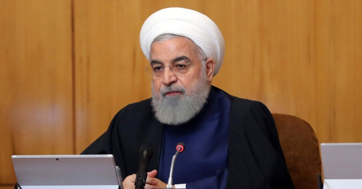 In this photo released by the official website of the office of the Iranian Presidency, President Hassan Rouhani heads a cabinet meeting in Tehran, Iran, Wednesday, May 8, 2019. (Iranian Presidency Office via AP)